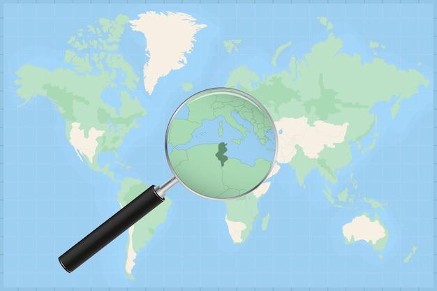 Kaart van de wereld met een vergrootglas op een kaart van tunesië.