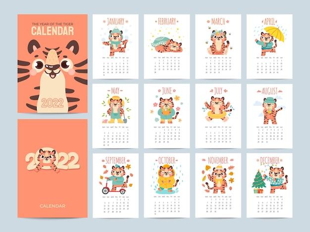 Kalender 2022 met schattige tijgers. omslagen en pagina's van 12 maanden met seizoensactiviteiten van dierenfiguren. chinees nieuwjaar symbool vector planner. chinees tijgerkarakter tot 2022 kalenderjaarillustratie