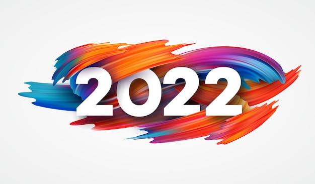 Kalenderkop 2022 nummer op kleurrijke abstracte kleur verf penseelstreken. gelukkig nieuwjaar 2022 kleurrijke achtergrond.