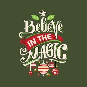 Kalligrafie belettering kerst citaat met lamp achtergrond. geloof in de magie