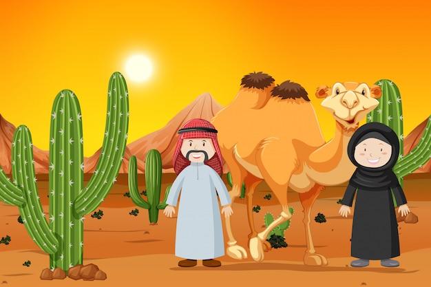 Kameel en twee moslimmensen