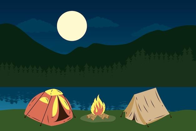Kampeertenten met kampvuur in het meer bij nachtscène