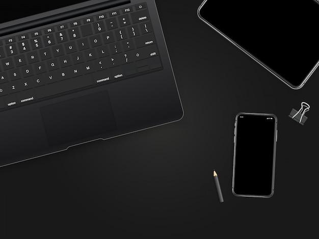 Kantoorwerkplaats met zwarte gadgets