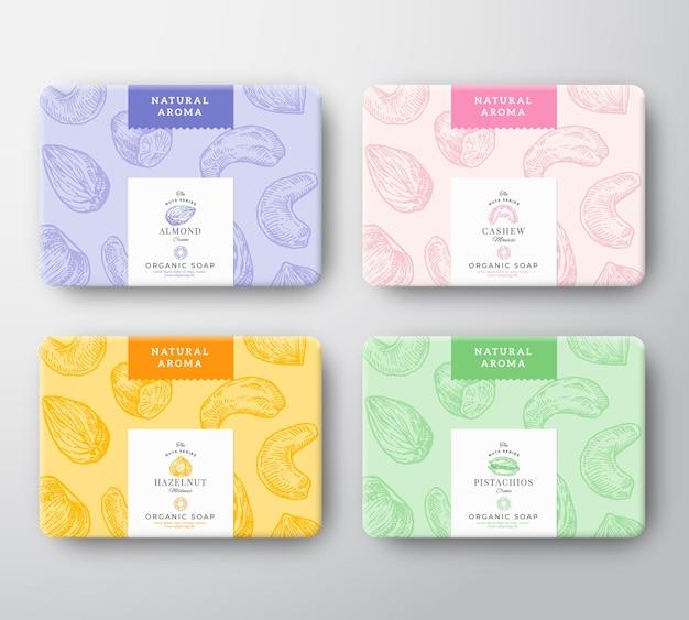 Kartonnen doosjes met amandel-, cashewnoten-, hazelnoot- en pistachezeep.