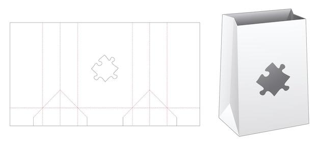 Kartonnen zak met gesjabloneerde, gestanste sjabloon in de vorm van een puzzel Premium Vector