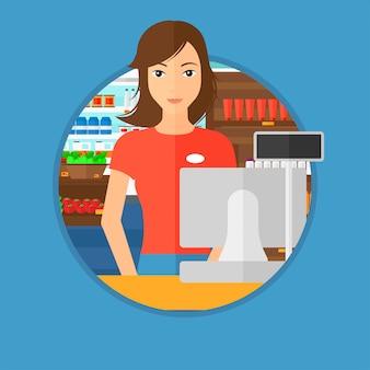 Kassier die zich bij de controle in supermarkt bevindt.