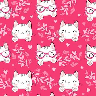 Katten met bloemenornament en hartenpatroon