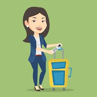 Kaukasische bedrijfsvrouw die bagagelabel toont.