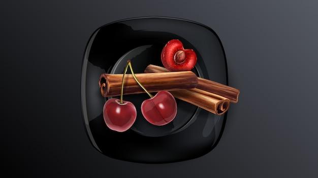 Kersenbessen en pijpjes kaneel op een zwarte plaat.