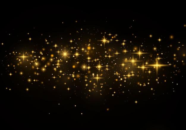 Kerst abstract stijlvol lichteffect. gele stofgele vonken en gouden sterren schijnen met speciaal licht. luxe schittert sprankelende magische stofdeeltjes.