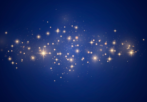 Kerst abstract stijlvolle lichteffect op een blauwe achtergrond. gele stofgele vonken en gouden sterren schijnen met speciaal licht. luxe schittert sprankelende magische stofdeeltjes.