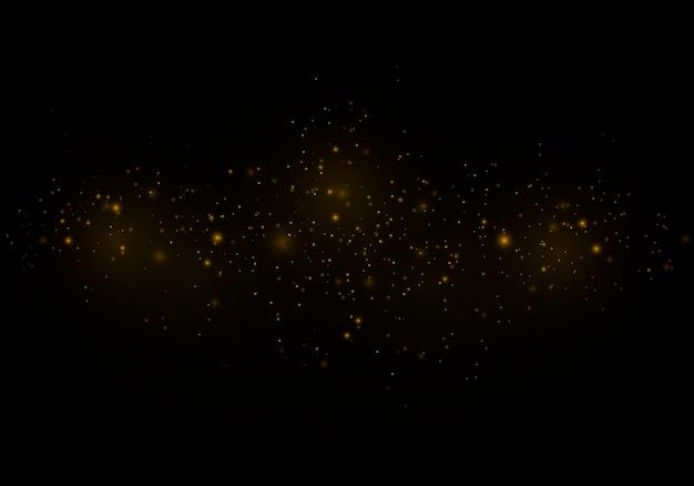 Kerst abstract stijlvolle lichteffect op een zwarte transparante achtergrond. gele stofgele vonken en gouden sterren schijnen met speciaal licht. sprankelt sprankelende magische stofdeeltjes.