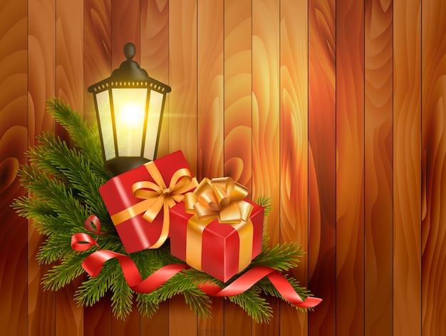 Kerst achtergrond met cadeautjes en een lantaarn.