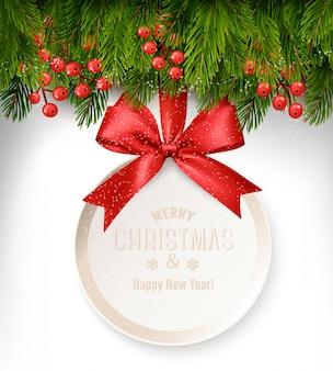 Kerst achtergrond met een cadeaubon en takken van de boom