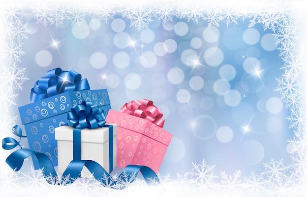 Kerst achtergrond met geschenkdozen en blauwe linten.