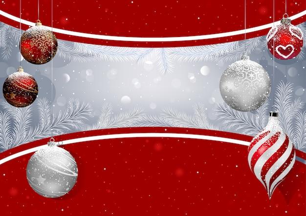 Kerst achtergrond met kerstballen en besneeuwde takken