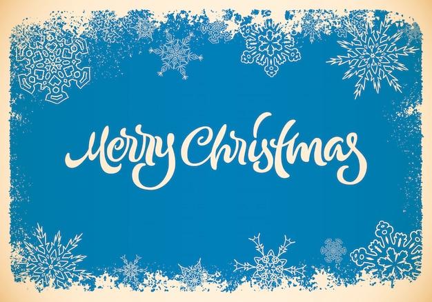 Kerst belettering achtergrond met hand getrokken letters en sneeuwvlokken