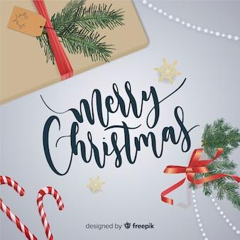 Kerst belettering met realistische elementen