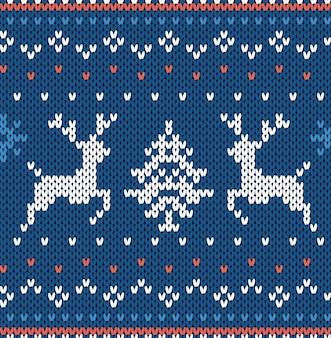 Kerst brei geometrische achtergrond met elanden in blauwe kleuren. gebreide gestructureerde achtergrond. illustratie.