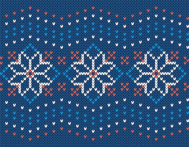 Kerst brei naadloos patroon. blauwe gebreide trui textuur. print met bloemen. xmas achtergrond.