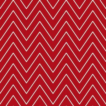 Kerst chevron patroon abstracte achtergrond met witte zigzag strepen op een rode achtergrond vector i...