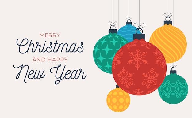 Kerst en nieuwjaar wenskaart of banner. hangende kerstballen van slingers en sterren.