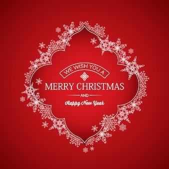 Kerst- en nieuwjaarskaart met inscriptie in elegant frame en mooie sneeuwvlokken op rood