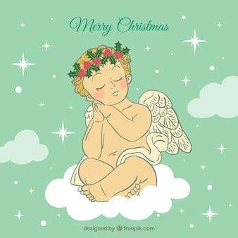 Kerst engel op een wolk met bloemen in zijn haar