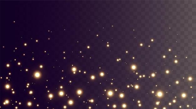 Kerst feestelijke achtergrond van lichte confetti en kleine glanzende gouden lichten