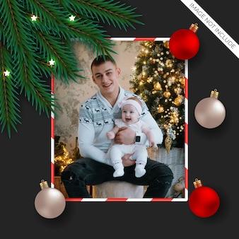 Kerst fotolijst met dennentak en bal