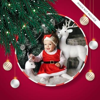 Kerst fotolijst met dennentak en kerstbal