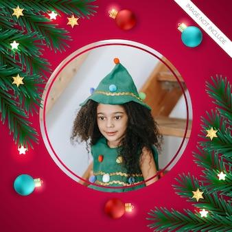 Kerst fotolijst pijnboomtak en kerst rood blauwe bal