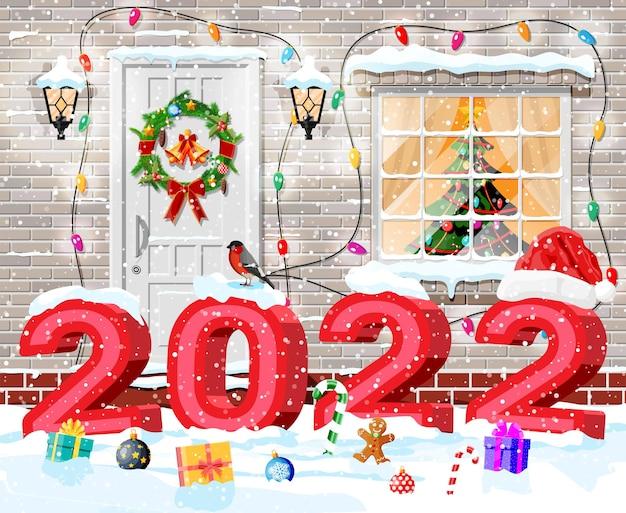 Kerst geveldecoratie met 2022 vette letters