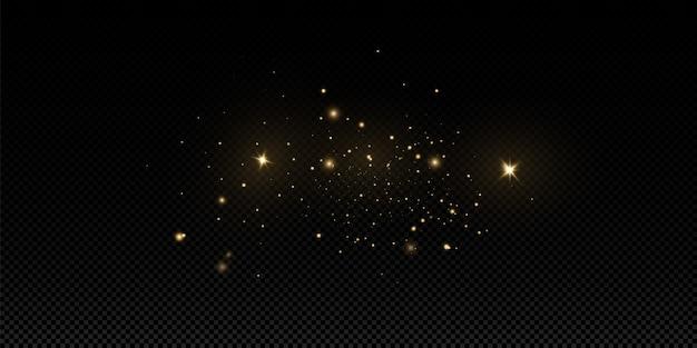 Kerst gouden stof, gele vonken en gouden sterren schijnen met een speciaal licht. schittert met sprankelende magische stofdeeltjes.
