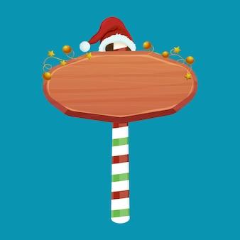 Kerst houten bord verkeersbord op gestreepte stok met kerstmuts en gouden slinger