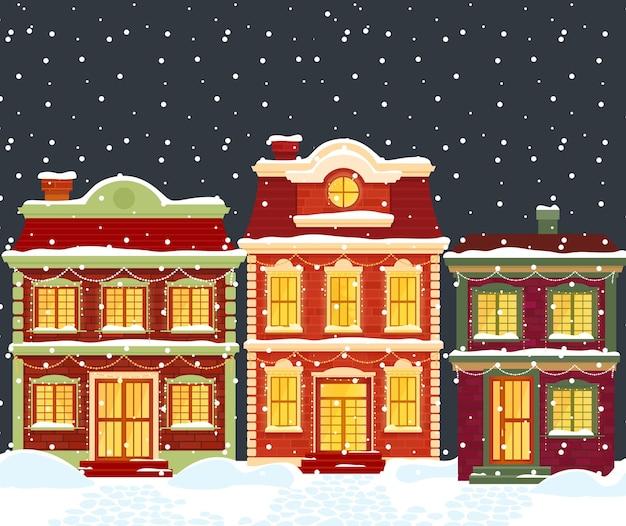 Kerst huizen. cartoon winterlandschap stad, herenhuizen met verlichting en vakantie decoratie