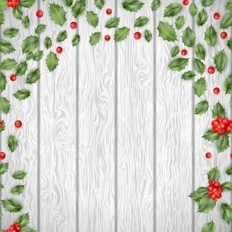 Kerst hulst op een houten achtergrond. en omvat ook