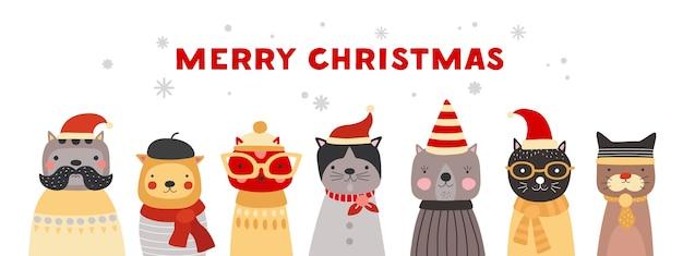 Kerst katten. schattige kittens in kerstmutsen, winterhoofddeksels en glazen. gelukkig xmas huisdieren vector wenskaart.