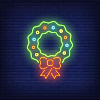 Kerst krans neon teken element. kerst concept voor heldere nachtadvertentie