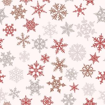 Kerst naadloos patroon met complexe grote en kleine sneeuwvlokken, gekleurd op witte achtergrond