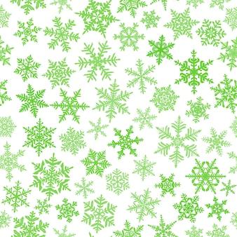Kerst naadloos patroon met complexe grote en kleine sneeuwvlokken, groen op witte achtergrond