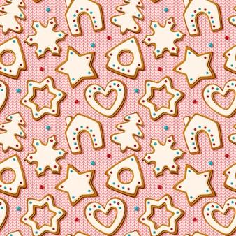 Kerst naadloos patroon met peperkoekkoekjes op roze gebreide achtergrond. zelfgemaakte koekjes in de vorm van huis en kerstboom, ster en sneeuwvlok en hart. vector illustratie