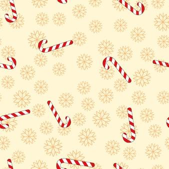 Kerst naadloos patroon met snoep en sneeuwvlokken.