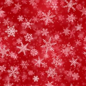 Kerst naadloos patroon van complexe vage en duidelijke vallende sneeuwvlokken in rode kleuren met bokeh-effect
