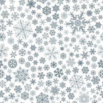 Kerst naadloos patroon van grote en kleine sneeuwvlokken, blauw op wit