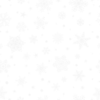Kerst naadloos patroon van grote en kleine sneeuwvlokken, grijs op wit