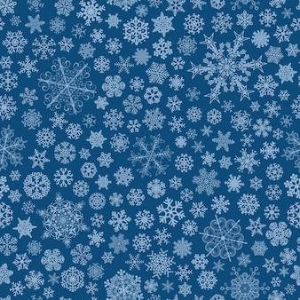 Kerst naadloos patroon van grote en kleine sneeuwvlokken, lichtblauw op blauw