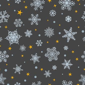 Kerst naadloos patroon van grote en kleine sneeuwvlokken, wit op grijs