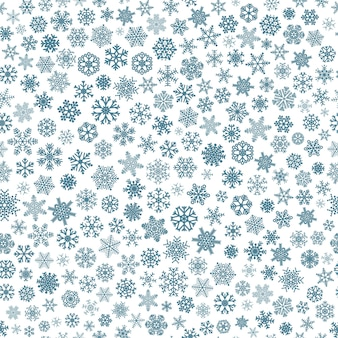 Kerst naadloos patroon van kleine sneeuwvlokken, blauw op wit