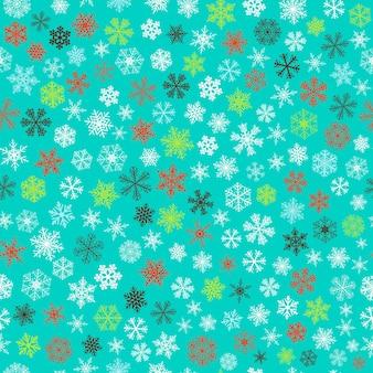 Kerst naadloos patroon van kleine sneeuwvlokken, wit, rood en groen op turkoois